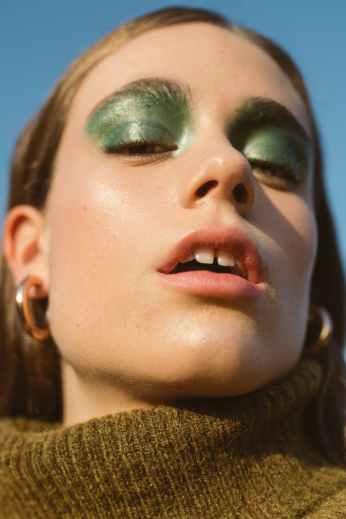 woman wearing green eyeshadow
